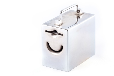 metal money box and coin over white photo
