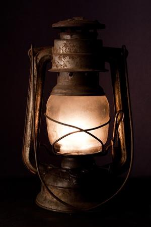 Old kerosene lantern burning with bright flame  Stock Photo - 12815709