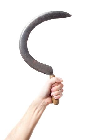 guadaña: mano que sostiene una hoz Foto de archivo