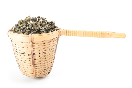 tea strainer with green tea photo