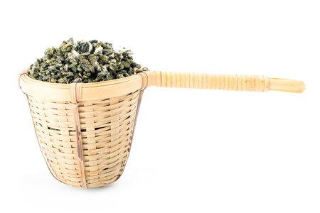 tea strainer with green tea on white photo