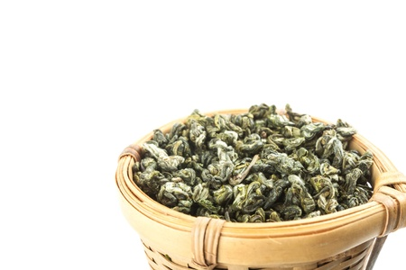 tea strainer: tea strainer with green tea on white