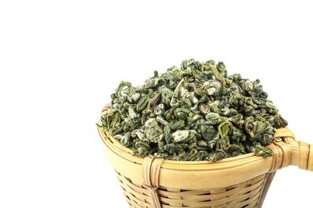 tea strainer with green tea on white