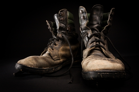 muddy clothes: Old army boots