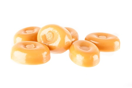 Caramel candies isolated on a white background Stock Photo