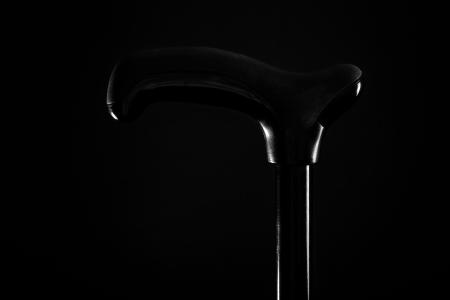 brass rod: walking stick isolated on black background Stock Photo