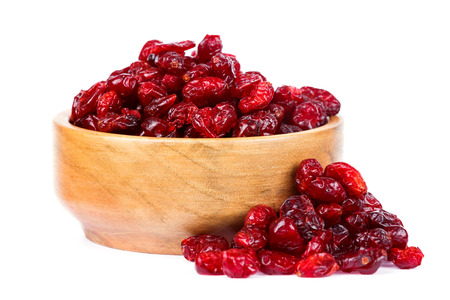 A bowl of dried cranberries on a white background
