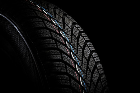 winter tires: Car tires. Winter wheel profile structure on black background