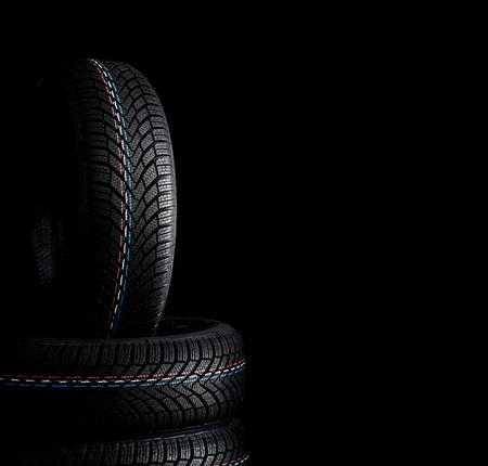 Car tires. Winter wheel profile structure on black background