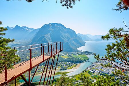 Observation deck Rampestreken in Andalsnes, Norway. Beautiful view on the mountains, the city and the fjords. Tourist place in Norway.