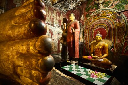 Sitting Buddha, statue in Dambulla cave temple. UNESCO Golden Temple of Dambulla, beautiful sacred place in Sri Lanka. Very popular tourist place. Reklamní fotografie
