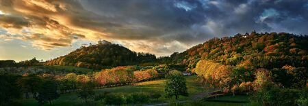Panorama of hills with old castle. Beautiful autumn colors. Reklamní fotografie