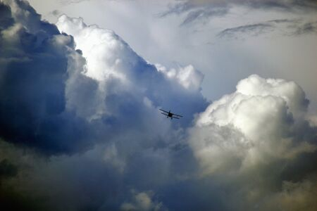 stormy clouds: wild stormy clouds on the sky with airplane