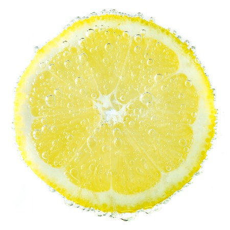 Fresh lemon in soda water covered with bubbles  isolated on white background Stock Photo