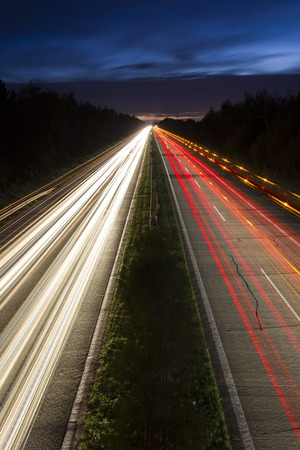 highway lights: Night highway lights made by moving cars