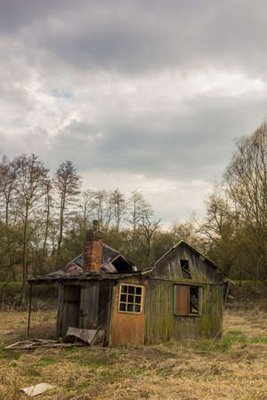 Abandoned cabin in the swamps in winter
