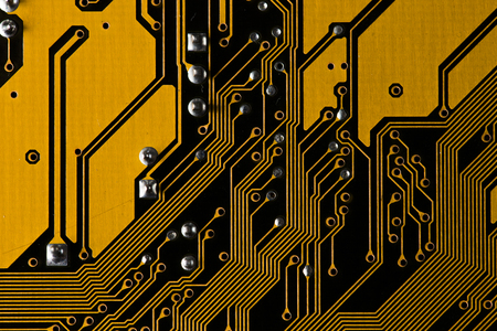 Macro picture of yellow printed circuit board - PCB texture