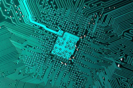 Close up photo of teal pcb printecd circuit board electric paths Banco de Imagens