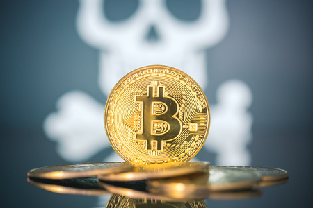 Bitcoin fail concept, Golden bitcoin with skull and bones in the background.
