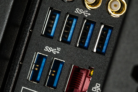 Close up of input output panel in the back of a computer with USB 3.0 ports
