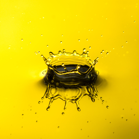Close up of water droplet or splash-Image, yellow backgroung