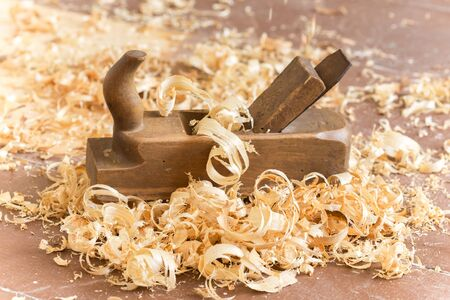 Old wooden hand plane for woodworking.