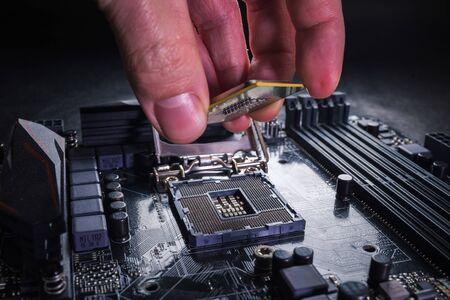 Installing modern central processor unit into motherboard Imagens
