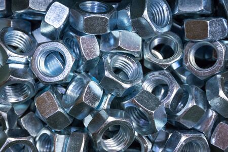 A pile of galvanized industrial nuts.