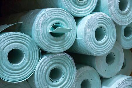 Pile of insulation material rolls. Light green or blue color. Filled frame. Banco de Imagens