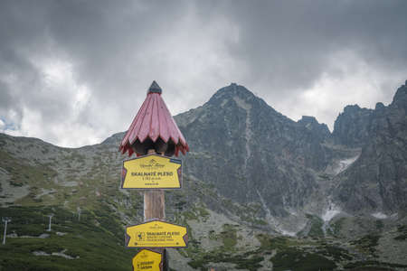 TATRANSKA LOMNICA, SLOVAKIA, AUGUST 2020 - Skalnate pleso sign on wooden pole with roof in Slovakia. It is a lake located in the High Tatras mountains in the north of Slovakia Editorial