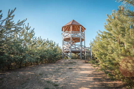 Rozhledna Kosice is a lookout tower in the forest park ner city Chlumec nad Cidlinou. It ios made of wood and it is 8m tall. Observation tower picture from summer. Standard-Bild