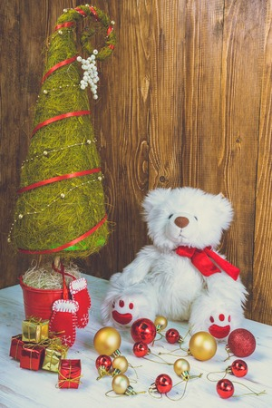 chiming: Christmas tree decorations. Toy bear and little presents