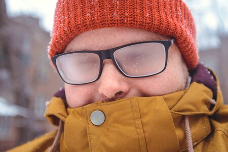 misted: misted glasses of young man outside, winter day Stock Photo