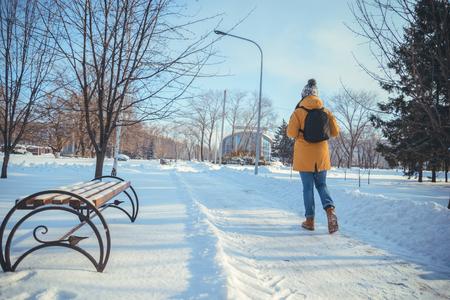 winter woman: woman walking in winter park
