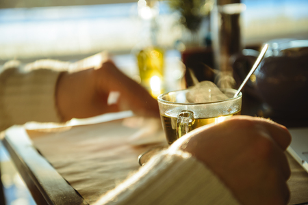 man siting in caffe and drinking tea Stock Photo