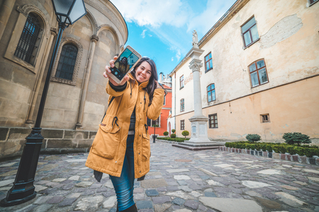 young pretty woman tourist taking slefie