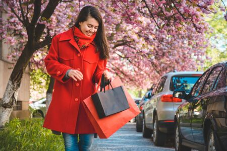 happy young women walking after shopping Stock Photo