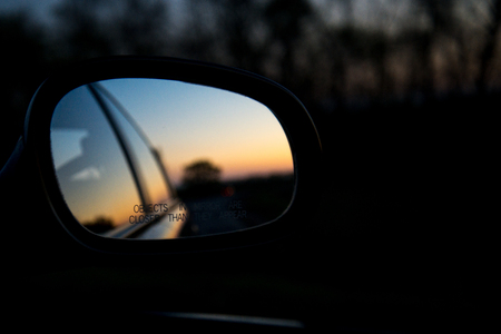 Blue landscape sunset reflect in mirror of car Stock Photo
