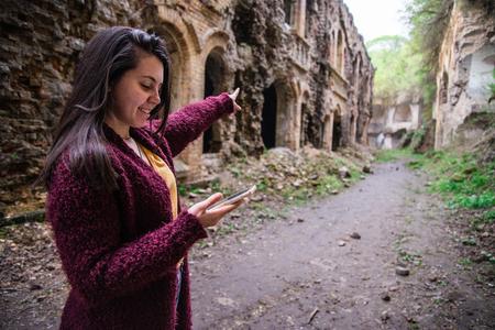 woman shows way using mobile maps Фото со стока
