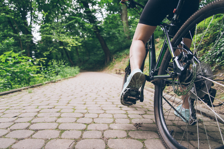 showy: womans leg with dirty of oil from chain on bicycle Stock Photo