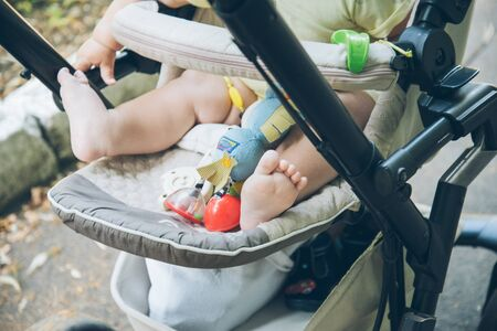 fasten: baby legs in baby carriage
