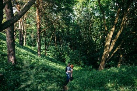 prety: man and woman walking by farest trail Stock Photo