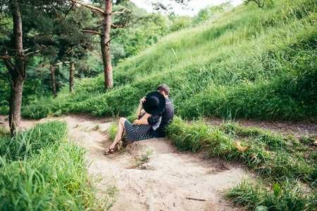 stilish: couple resting on trail and hugging each other