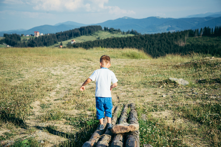 little boy playing on the top of the mountains Reklamní fotografie
