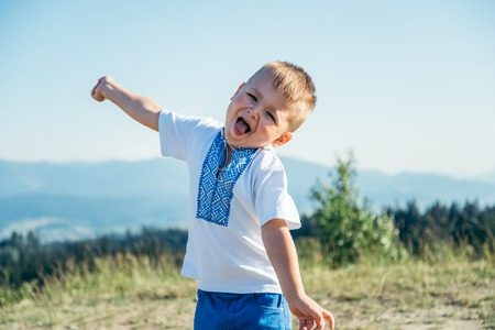 little boy playing on the top of the mountain Stock Photo