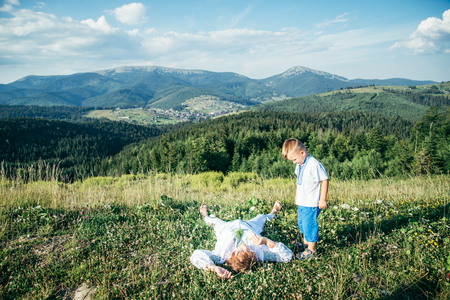 res: grandmother lying on the peak of the hill and enjoing the view