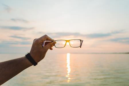 sunrise through eyeglasses