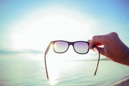 sunrise through sunglasses Stock Photo