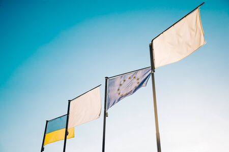Flags of Ukraine and European Union EU fluttering in the wind