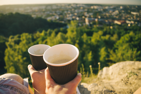 hands with two cups of coffee Stock Photo